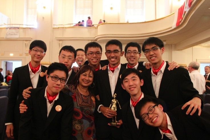 Mrs Jasbir Koh (front, 2nd from left) with Raffles Chorale and the trophy they won in 2012