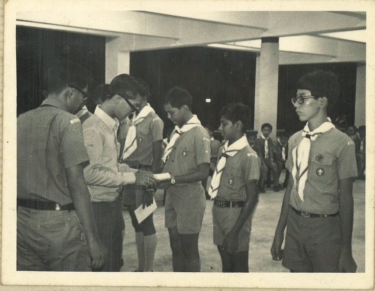 Mr Chan being invested as a Patrol Leader at the 02 Scouts Investiture Ceremony, 1972
