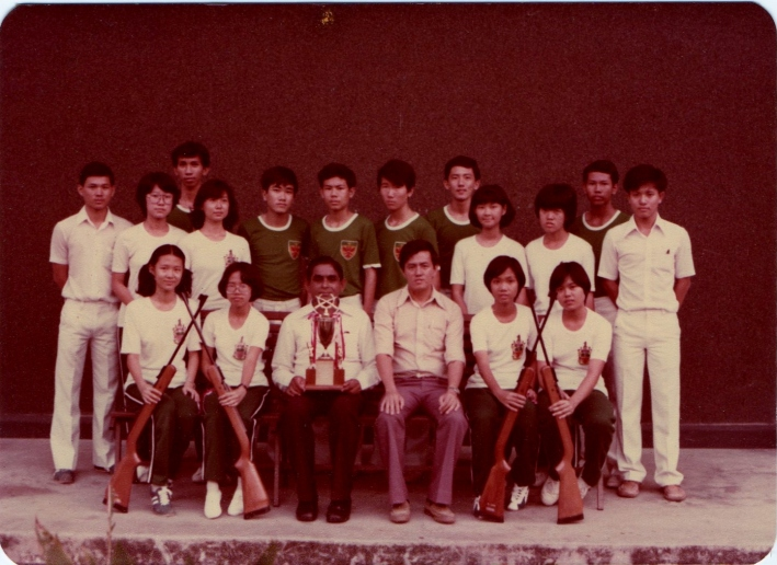 Ms Tan (front row, first from left) with the 1978 A-Division Air Rifle team, Principal Mr A K Sigamoney (front row, third from left) and teacher-in-charge Mr Sim (front row, fourth from left)