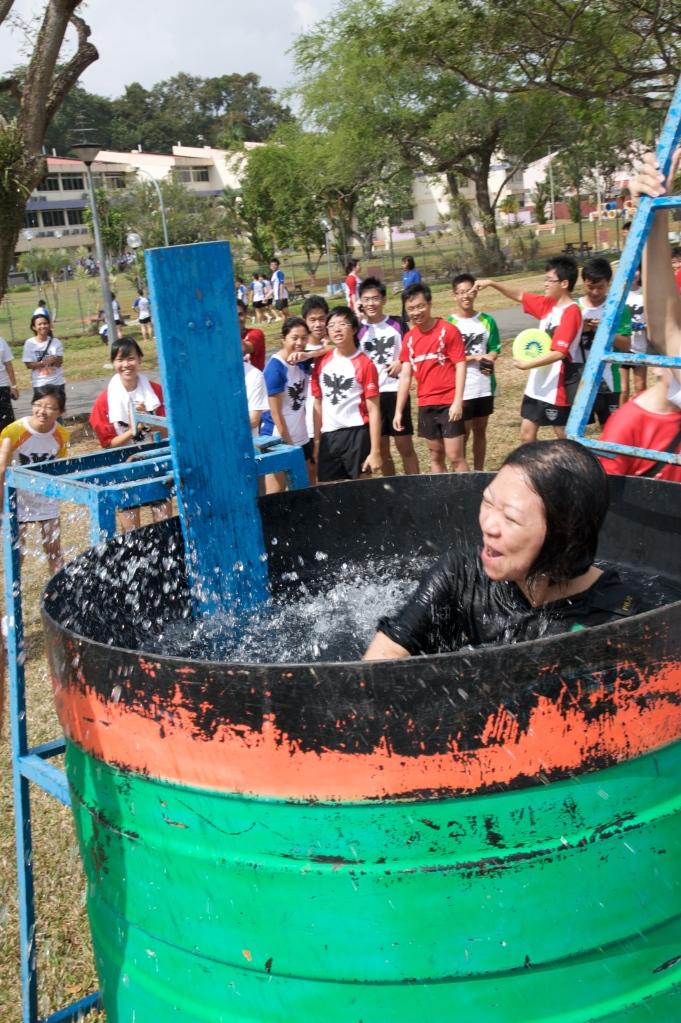 Soaking up the Rafflesian Spirit: Mrs Lim gets dunked at Take 5, 2009