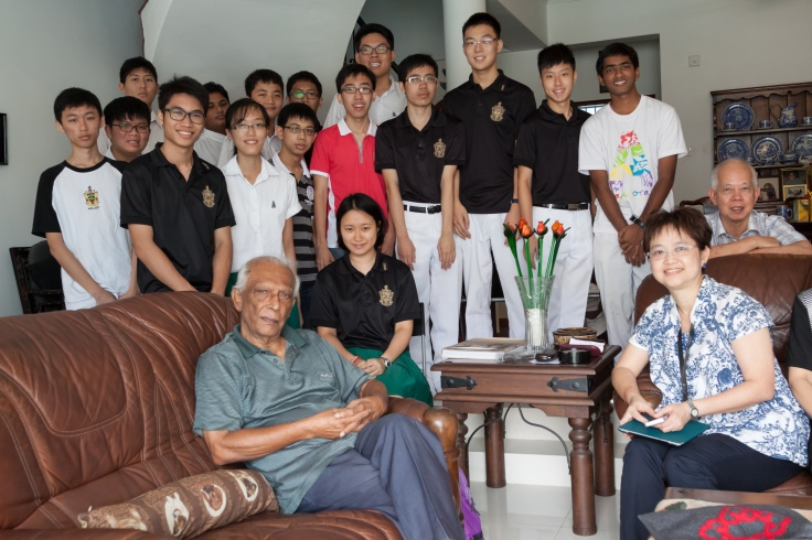 Students from Year 1-6 with an interest in school heritage visit Mr Wijeysingha at his home in Seletar Hills. On the right are Mrs Cheryl Yap, Head of the Raffles Archives & Museum (RAM) and Mr Siu Kang Fook (RI, 1968), who has been volunteering with the set-up of RAM.