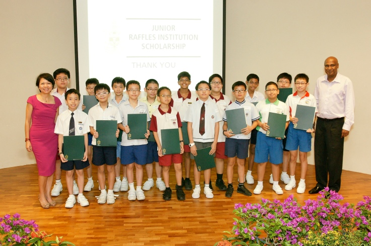 Principal Mrs Lim Lai Cheng (far left) and Senior Deputy Principal Mr S Magendiran (far right) with the 2013 recipients of the Junior RI Scholarship