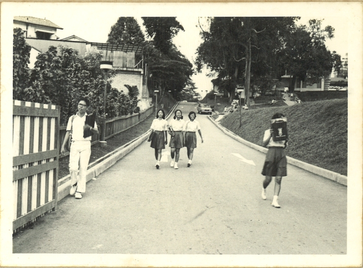 A young Mr Chan leaving the Grange Road campus via its Kay Poh gate