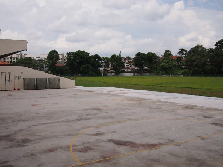 View of the parade square and field at the former RJC Mount Sinai campus, which is currently housing Raffles Girls' Primary School. The old KTM railway used to run in the background behind the field until its closure in 2011.