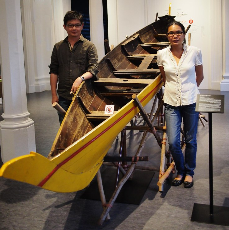 Marcus Ng and Yu-Mei Balasingamchow by a kolek sauh, a typical mode of transportation between islands