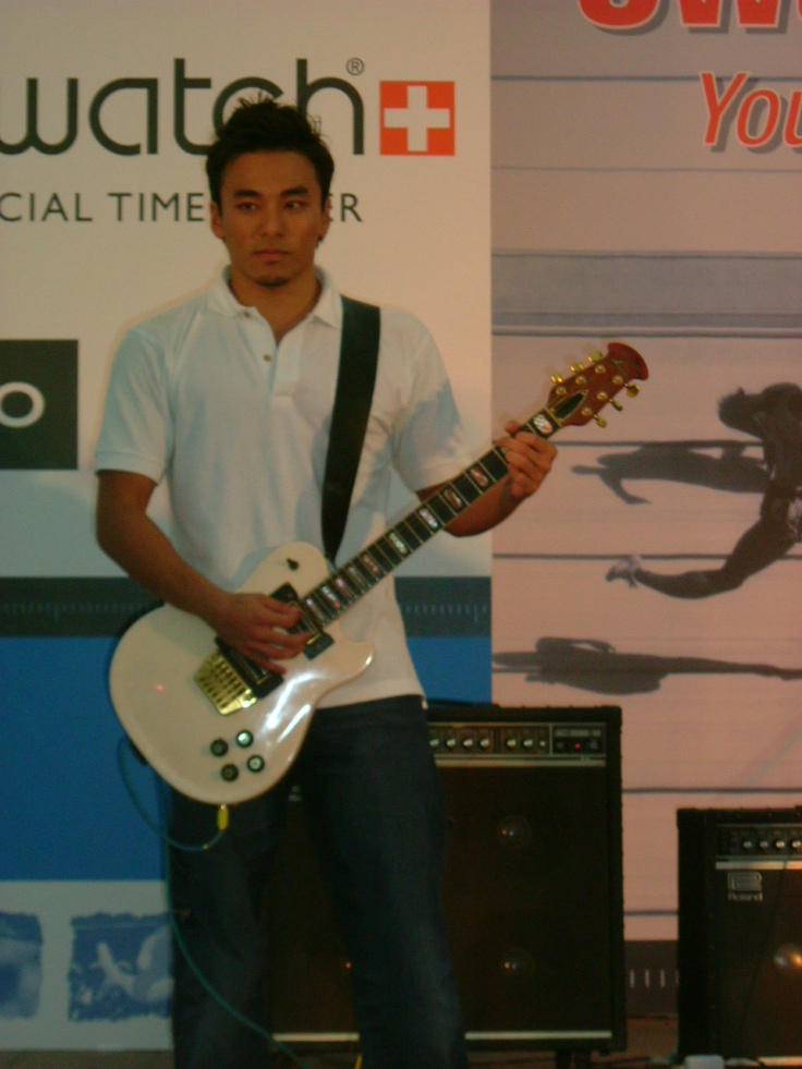 Mr Lim Yao Xiang performing for his band, the Swim Shadys