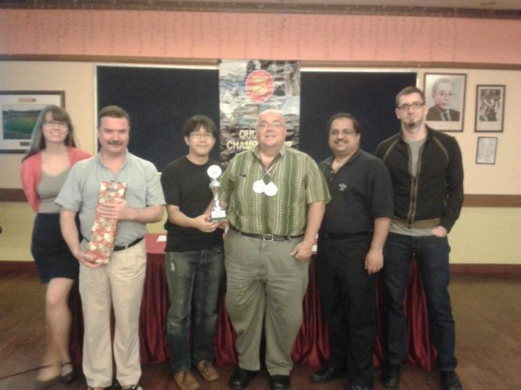Mr Liu (third from left) with his quizzing team for the 2012 SEA Championships