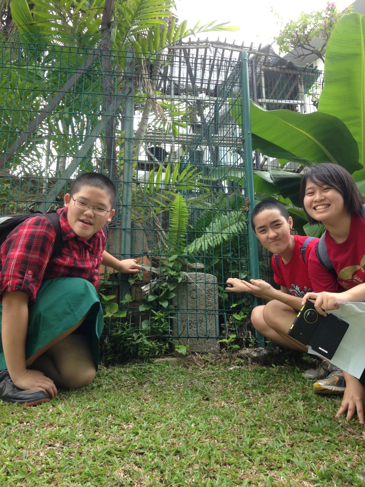 Students found Peck San Theng cemetery boundary markers along the perimeter of Catholic High School and that of Pemimpin Estate