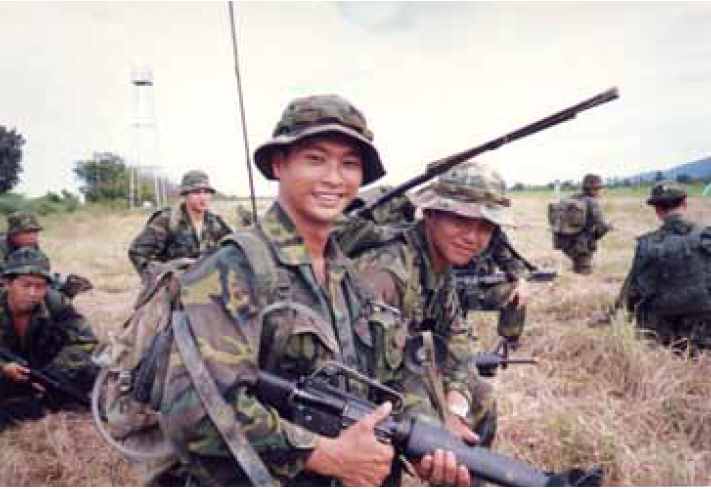 Mr Kuak taking part in a military exercise