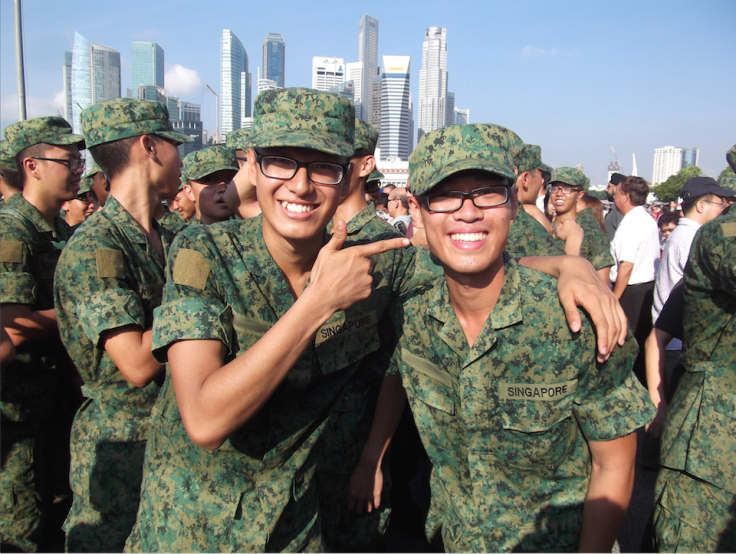 Samuel (right) and his buddy at their Passing Out Parade
