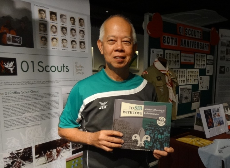 Mr Siu posing proudly with the book on RI's Scouting History.