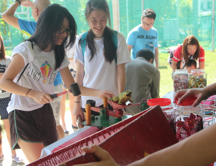 Students trying out various games at the Founder's Day Carnival