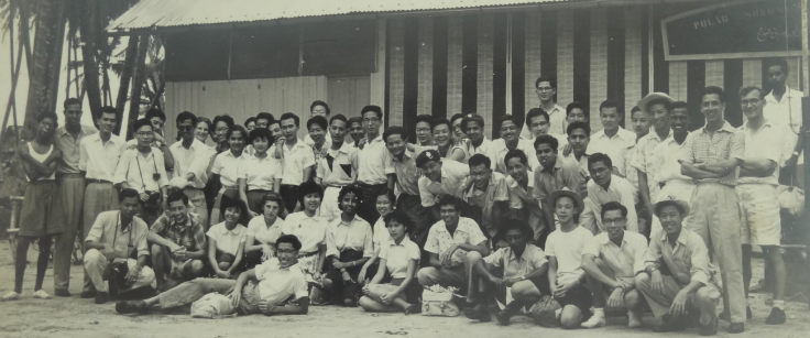 Professor Koh participated in this 1956 trip to Pulau Sudong. In this photograph, he is standing next to a boy with two black triangular patches on his shirt.